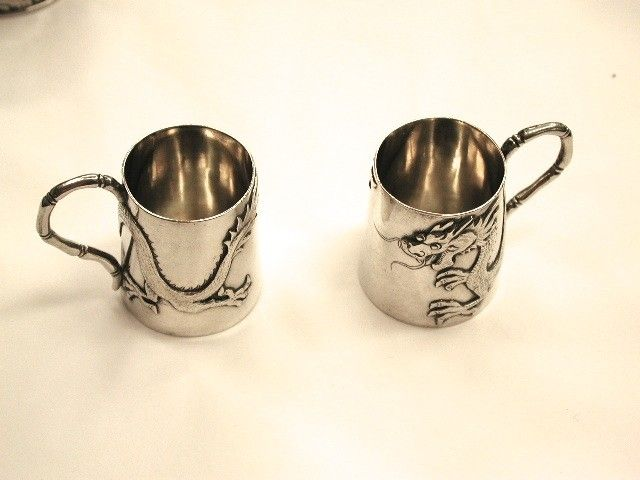 Pair of Chinese Silver Drinks measures with Dragon Motif