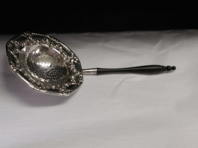 Silver Teastrainer with Ebony Handle