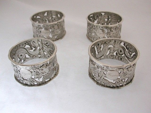 Set of 4 Chinese Silver Napkin Rings with Pierced Dragon Motif