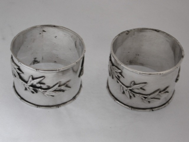 Pair of Chinese Silver Napkin Rings with Bamboo and Bird decoration.