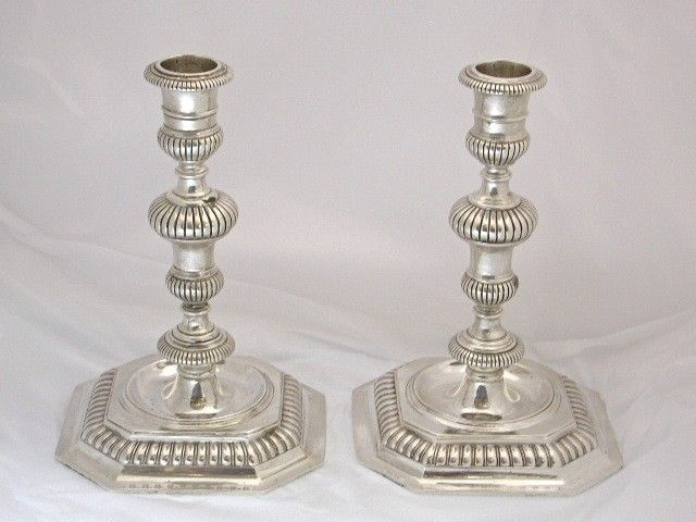 Pair of Cast Silver Candlesticks